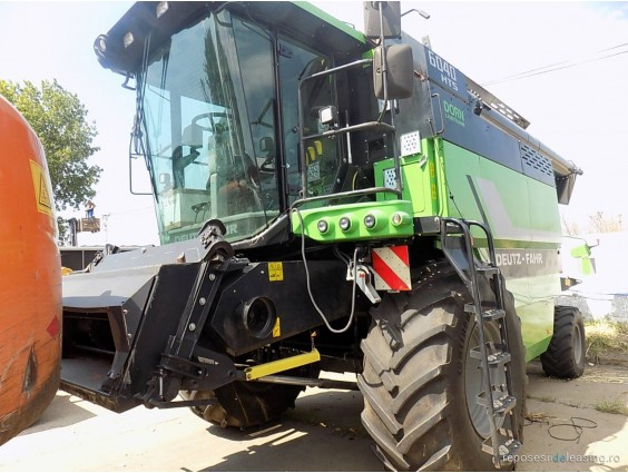 Combină agricolă Deutz Fahr 6040 HTS din 2015 cu heder de păioase